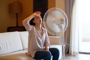 woman-on-couch-with-fan